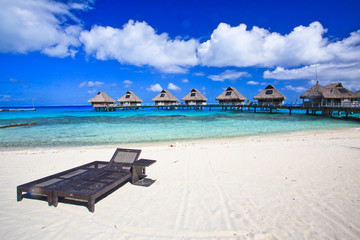 Beach chair on white sand sand beach, Bora Bora, French Polynesia, South Pacific Concept for relaxation, vacation, resort