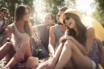 Group of friends talking and laughing on the beach