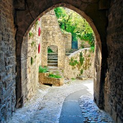 View through a medieval archway in a village in Provence, France
