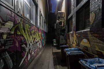 Melbourne, Australia - April 21, 2015: Graffitis on the walls in a dark alleyway of Melbourne.