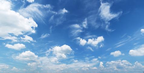 White heap clouds in the blue sky.