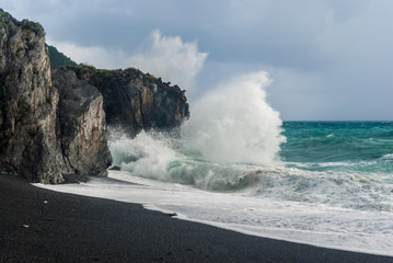 A big wave breaking on the cliff, near Maratea