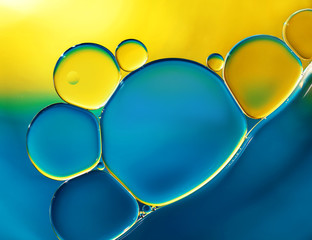 Abstract background with oil drops on water