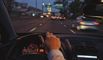 Driving the car around town by night