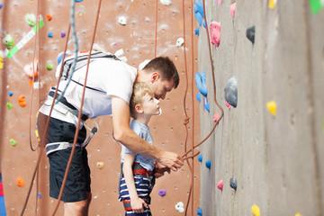 boy rock climbing