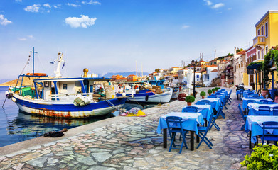 traditional Greece series - Chalki island with old boats and tavernas