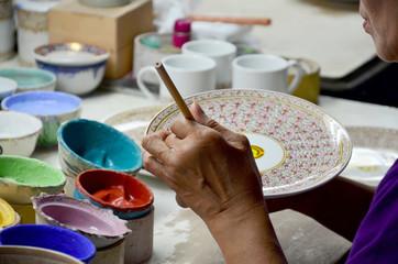 Thai people woking process paint Ceramic Benjarong is traditiona