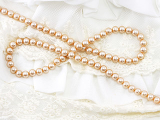 beautiful creamy pearl necklace on a lace background