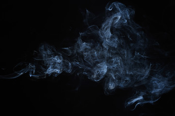 abstract smoke moves on a black background.design elements. abstract texture.