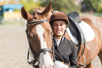 Young rider girl with her horse