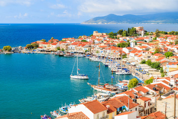 A view of Pythagorion port with colourful houses and blue sea, Samos island, Greece.