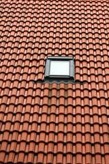 Single window on red roof
