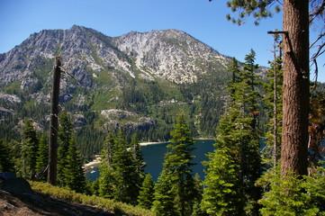 Mountains arise from shoreline at Lake Tahoe California.