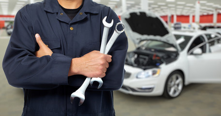 Hand of car mechanic in auto repair service.