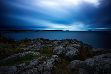View from cliff by the baltic sea archipelago in dusk. Long exposure