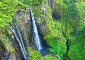 Aerial view to waterfall in rainforest. Cirque Salazie, Reunion Island.
