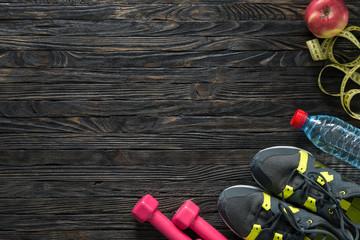 sport fitness items on dark wooden background