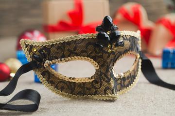 Beautiful carnival mask with christmas balls.