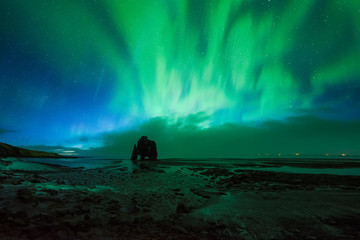Beautiful Aurora Borealis, Northern light at Hvitserkur, Iceland