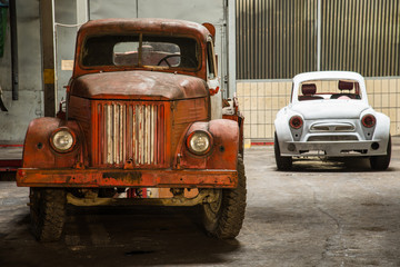Car station. Old truck and passenger car