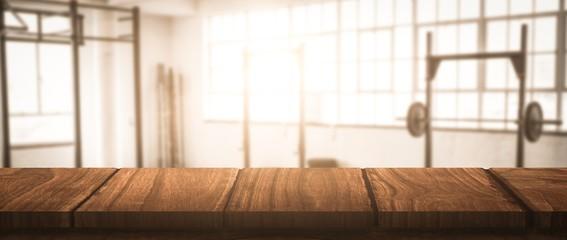 Composite image of wooden desk