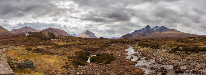 Panoramic skyline of the Glamaig, the Sligachan and the Cuillin mountains on a cloudy day at Isle of Skye - Scotland, UK