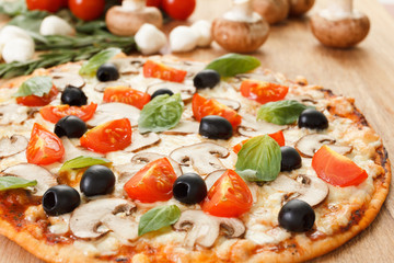 Pizza with mushrooms and vegetables
