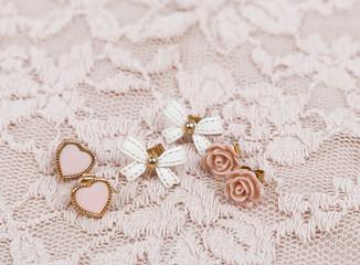 Earrings on lace