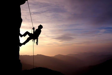 Silhouette of Rock Climber at Sunset