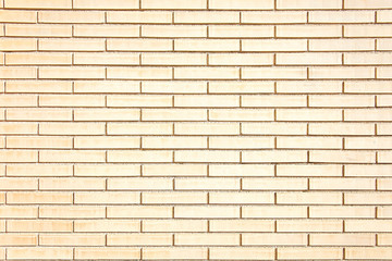 New beige brick wall background texture