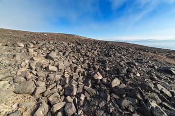 Stone desert under blue sky.