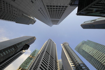 Skyscrapers in Singapore. Highrise buildings ,City view with wide angle lens, looking straight up.