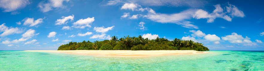 Panorama of idyllic island and turquoise ocean water
