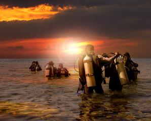 group of scuba diving preparing to night diving at sea side agai