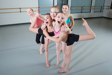 Group of young girls having fun in dance studio