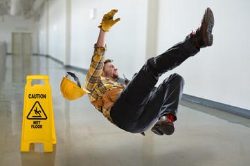 Worker Falling on Wet Floor