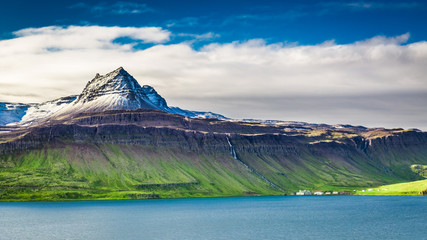 Volcanic mountain over fjord, Iceland