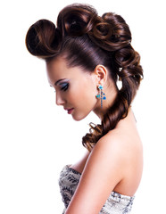 Profile  portrait of a beautiful woman with creative hairstyle