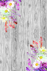 Bouquet of wild flowers is located on rustic wooden background w