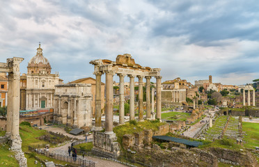 Dramatic sky above Roman Forum and Colosseum (Coliseum, Colosseo) in sunset time. Beautiful architectural and natural landscape. Panoramic view on the  famous touristic landmark. Rome. Italy. Europe.