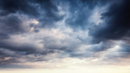Colorful dramatic sky with dark clouds
