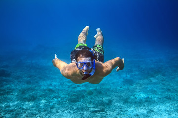 Underwater shoot of a young man snorkeling in a tropical sea