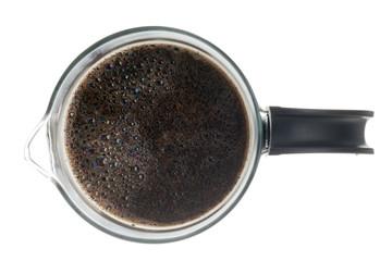 overhead view of black coffee in coffee mug.
