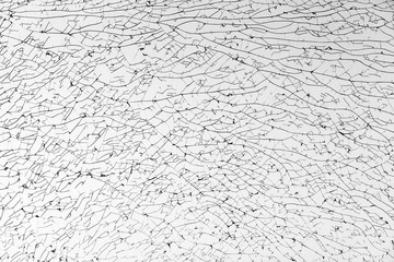 Broken glass with cracks pattern, monochrome photo