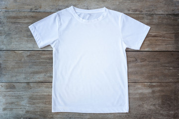 Top view of color T-Shirt on grey wood plank