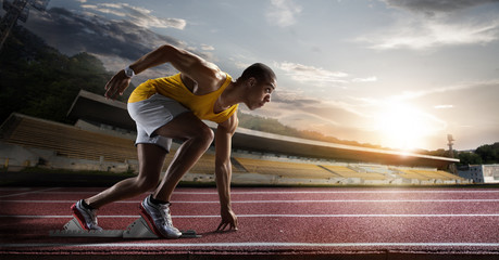 Sport. Sprinter leaving starting blocks on the running track.