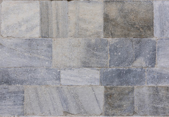 Marble Church Wall: Gray, pink and white colored marble wall blocks of the late Gothic Duomo di Como in Como, Italy