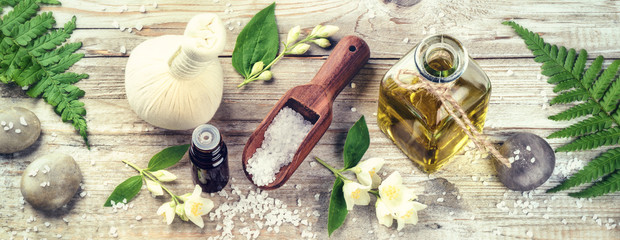 Spa setting with jasmine essential oil and flowers. Wellness con