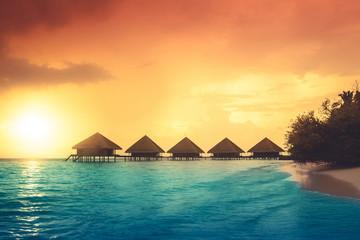 Zachód słońca na wyspie Malediwy