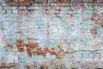 background old brick wall with remnants of plaster